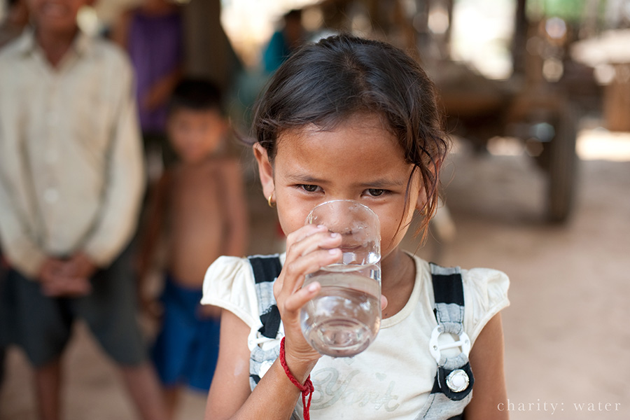 Cambodian girl drinking water